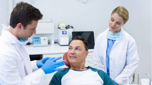 Dentist discussing oral pathology with patient - Oral Cancer Vallejo, CA