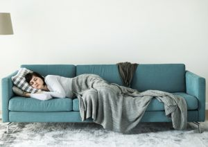 Woman resting on couch - Oral Surgery Vallejo, CA