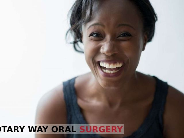 African American woman enjoying the benefits of smiling - Rotary Way, CA