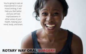 African American woman enjoying the benefits of smiling, with text - Rotary Way, CA