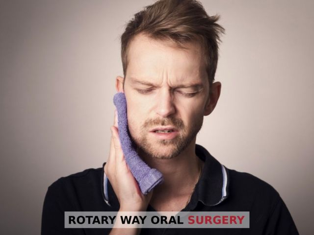 Man holding towel to his face in pain because of facial fractures -Rotary Way, CA