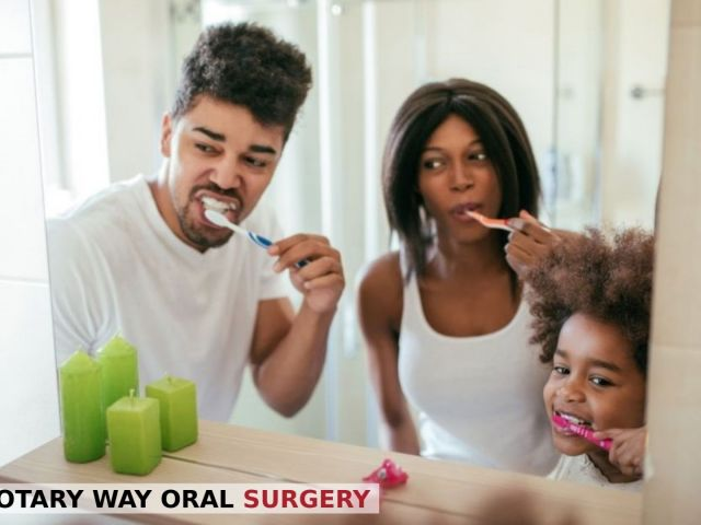 A mother and father brushing their teeth with little daughter for a healthy smile - Rotary Way, CA